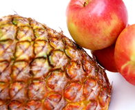Pineapples. Pineapple and apples grouped together Royalty Free Stock Photos