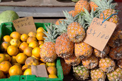 Pineapples And Oranges For Sale At Fruit Stand Royalty Free Stock Image