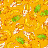 Pineapples and bananas Stock Images
