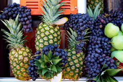 Pineapples and black grape Royalty Free Stock Photography