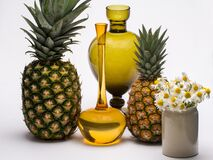 Pineapples, flowers and vases Stock Images