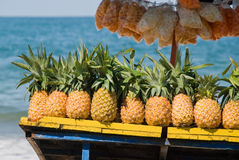Pineapples For Sale On Tropical Beach Royalty Free Stock Photos