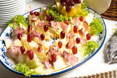 Pineapples with ham on tray at buffet in restaurant Royalty Free Stock Photo