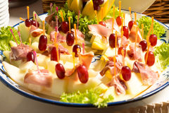 Pineapples with ham on tray at buffet in restaurant Stock Image