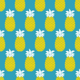 Pineapples seamless pattern. Tropic fruits background. Stock Photo