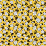 Pineapples. Seamless pattern of pineapples on a yellow background Royalty Free Stock Images
