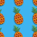 Pineappple seamless pattern. Ananas in paper cut style. Origami Healthy food on blue. Summertime. Stock Photos
