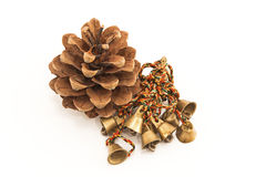 Pinecone and bells Royalty Free Stock Photo