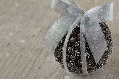 Pinecone christmas ball. On wooden background Stock Image