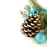 Pinecone with christmas decoration and blue ball over white Stock Photo