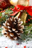 Pinecone with christmas decoration and snow Royalty Free Stock Images