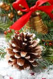 Pinecone with christmas decoration and snow Royalty Free Stock Image