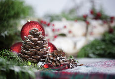 Pinecone with Christmas Ornaments Stock Photography