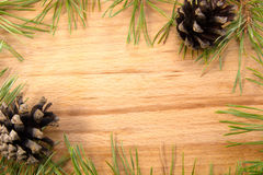Pinecone. Pine cones and branches lie on the wooden background Royalty Free Stock Image
