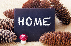 Pinecones and chalkboard with the word Home Stock Image
