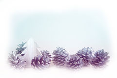 Pinecones and miniature wooden tree Stock Photo