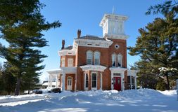 Pinehill Inn in Snow. This is a Winter picture of the historic Pinehill Inn located in Oregon, Illinois. The building was built by William Judd Mix, is an stock photography