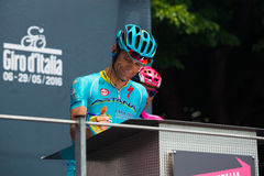 Pinerolo, Italy May 27, 2016; Michele Scarponi, Astana Team, to the podium signatures before the start of the stage Stock Images