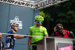 Pinerolo, Italy May 27, 2016; Moreno Moser, Cannondale Team, to the podium signatures before the start of  the hard mountain stage Royalty Free Stock Photo