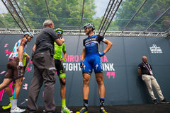 Pinerolo, Italy May 27, 2016; Moreno Moser, Cannondale Team, with Trentin and Brambilla to the podium signatures before the start Royalty Free Stock Image