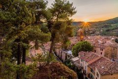 Pines and sunset in Moustiers Sainte Marie. Pines and sunset in the lovely village of Moustiers Sainte Marie in France Royalty Free Stock Image