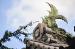 Pinetree With A Bokeh At The Background Of A Japanese Castle.  Royalty Free Stock Photography