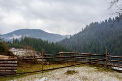 Pinewood fence on the background of winter Carpathian mountain.  Stock Photo