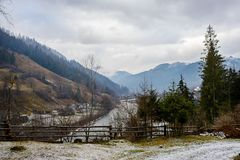 Pinewood fence on the background of winter Carpathian mountain.  Stock Photos