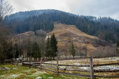 Pinewood fence on the background of winter Carpathian mountain.  Stock Image
