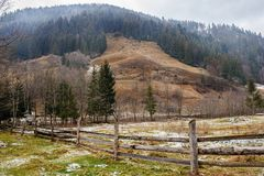 Pinewood fence on the background of winter Carpathian mountain.  Royalty Free Stock Images