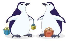 Pingüinos antárticos con los rectángulos de regalo ilustración del vector