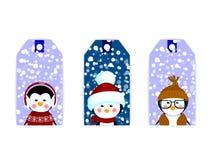 Pingüinos de la Navidad de la tarjeta de la etiqueta de la etiqueta Imagenes de archivo