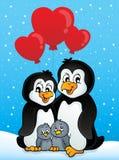Pingüinos de la tarjeta del día de San Valentín en nieve Fotos de archivo libres de regalías