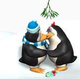 Pingüinos que se besan bajo el muérdago Fotos de archivo libres de regalías