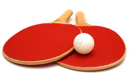 Ping Pong. Red wooden Ping Pong Paddes and ball isolation royalty free stock photo