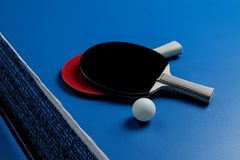 Ping pong. Accessories for table tennis racket and ball on a blue tennis table. Sport. Sport game. royalty free stock images