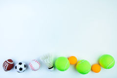 Ping pong ball, Football toy, Shuttlecock,Tennis ball, Basketball toy and Rugby toy isolated on white background with copy space. Ping pong ball, Football toy stock photo