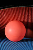 Ping pong ball with table tennis paddles. Close up of a ping pong ball with two paddles Stock Image
