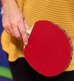 Ping pong bat. Close up shot of woman holding a Ping pong bat in her hand. Table tennis, also known as ping pong, is a sport in which two or four players hit a Stock Photo