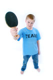 Ping Pong Boy. Boy wearing a light blue TEAM shirt holding a ping pong paddle Royalty Free Stock Photos