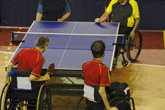 Ping pong game. Image of a disabled persons in wheelchairs playing a double table tennis game. Live image from an international tennis table competition for Royalty Free Stock Photography