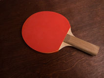 Ping Pong Paddle. Red Ping Pong Paddle on Wooden Table stock photography