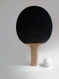 Ping Pong Paddle and Ball. Black Ping Pong Paddle and Ball Stock Photos