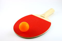 Ping Pong Paddle and Ball. A red table tennis paddle or bat and ball royalty free stock image