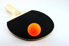 Ping pong paddle and ball. Closeup of a ping pong paddle and orange ping pong ball.  Game sometimes called table tennis.  White background Stock Photos