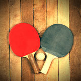 Ping pong paddle and ball Stock Images
