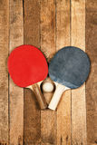 Ping pong paddle and ball Royalty Free Stock Photography