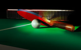 Ping pong. Paddle with ball, on a table-tennis board, at the foreground of the net Stock Photos