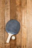 Ping pong paddle and ball Royalty Free Stock Photo