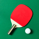 Ping pong paddle with ball Stock Images